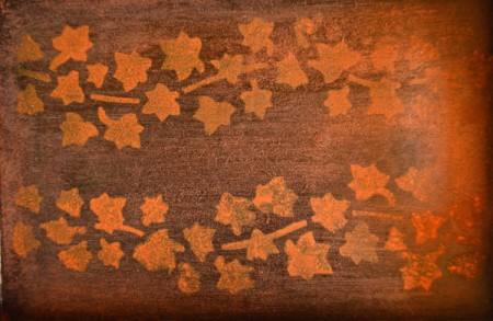 A lighter color stain was used to stamp leaves and a vine onto the bottom of the tray.