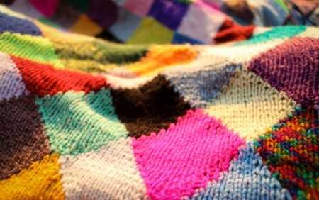 Quilt made from a variety of knitted squares