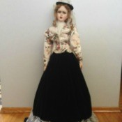 doll with long skirt and short flowered jacket