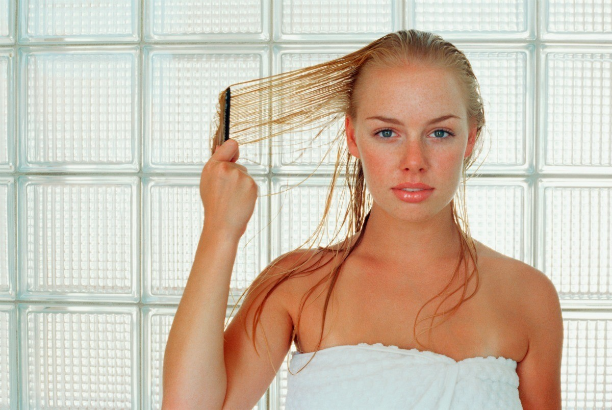 Woman In Towel Combing Wet Blond Hair This Is A Guide About Lightening Your Hair With Hydrogen Peroxide