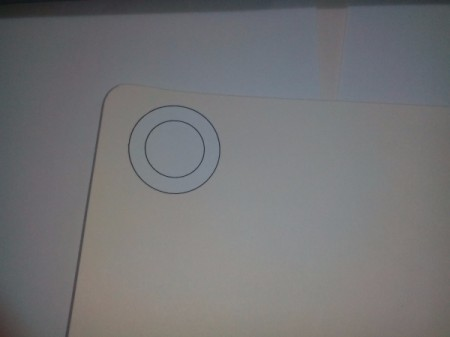 Piece of paper with a donut shaped paper template for photo frame.