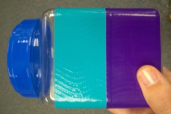 view of the back of the jar showing the two colors of tape
