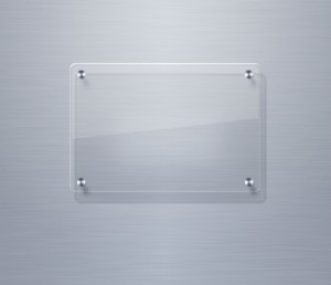 """Clear piece of glass with metal """"feet"""" glued on the corners"""