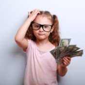 little girl with a fist of money