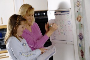 mother and daughter planning school work