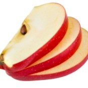 Three slices of red apple