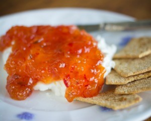 Pepper jelly over cream cheese served with Triscuits.