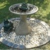 birdbath on circle of small cobbles with border