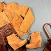 Display of suede jacket, pants, boots, and umbrella
