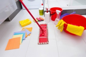 Floor cleaning tools like mop, rags, etc. displayed on vinyl tile floor