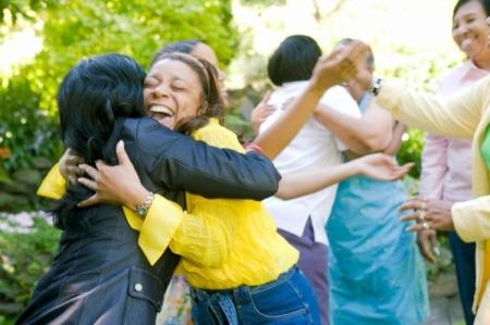 Women hugging outdoors