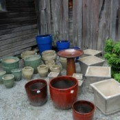 Bird Bath and several sizes of planters marked for sale.