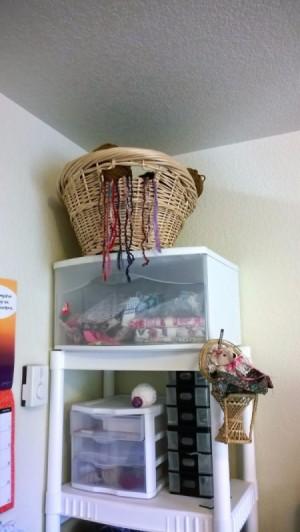 basket of yarn on top shelf