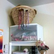 basket of yarn on top shelf