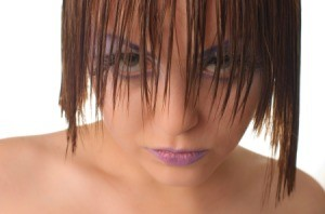 Model with heavy eye makeup and wet hair