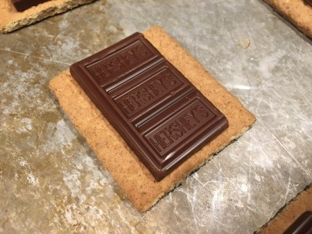 Baked Smores - putting Chocolate on cracker.