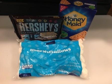 Bag of marshmallows, Hershey Chocolate bars, Honeymaid graham crackers.