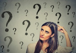 Woman trying to remember something with a question mark background.