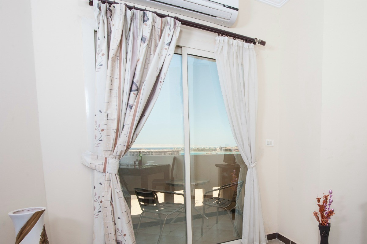 Full length curtains over a sliding glass door