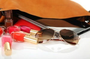 A handbag with makeup inside.