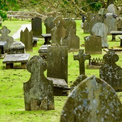 An old cemetery with headstones.