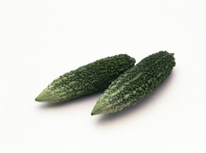 Two Chinese cucumbers on a white background.
