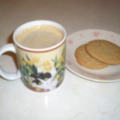 A pumpkin spice latte with some cookies.