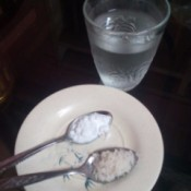 A homemade antacid remedy in spoons.