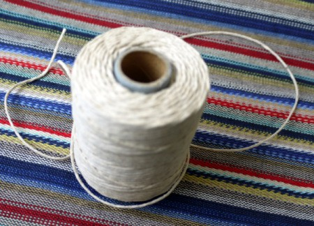 spool of plain white string