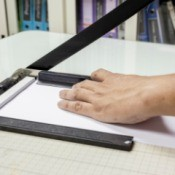 A paper cutter being used.