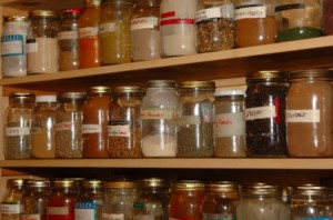 A fully stocked pantry lined with half full jars.
