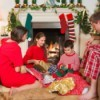 A young boy opening presents with his family on Christmas morning.