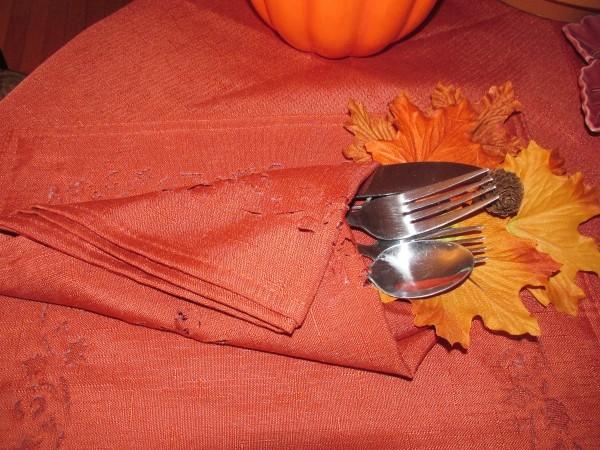 Festive flatware wrapped in a napkin.