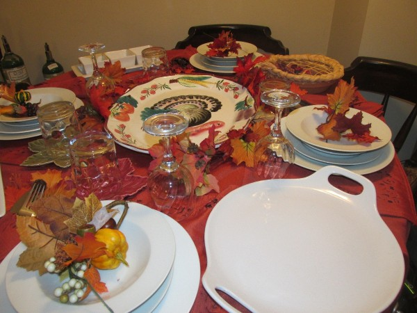 A table set with Thanksgiving dishes.