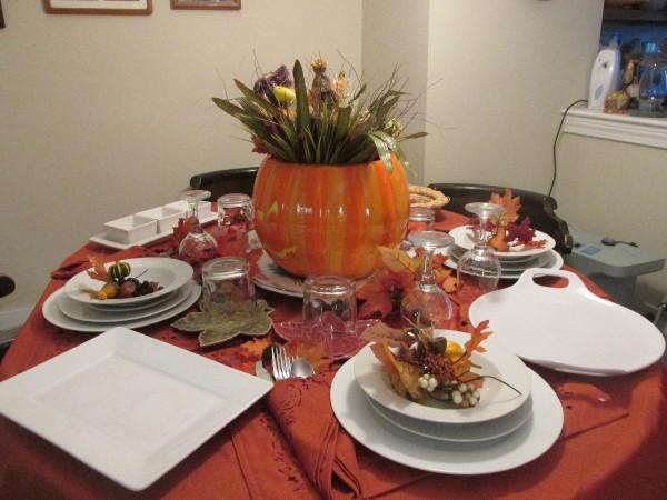 A pumpkin centerpiece for a Thanksgiving table.