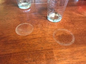 White rings left by drinks on a wood table.