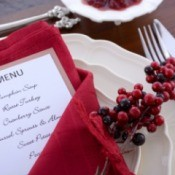 A place setting for Thanksgiving, including a menu.