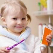 A toddler brushing her teeth.