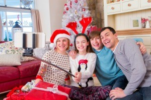A family taking a selfie with a new selfie stick at Christmas.