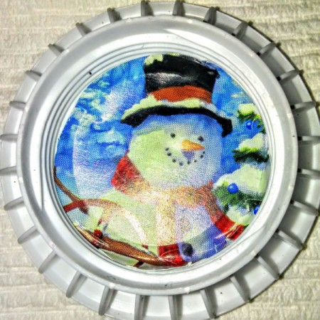 bottle cap with snowman picture inside