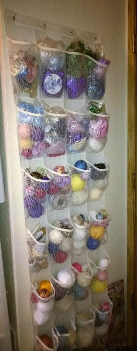 craft supplies stored in back of door shoe storage bag