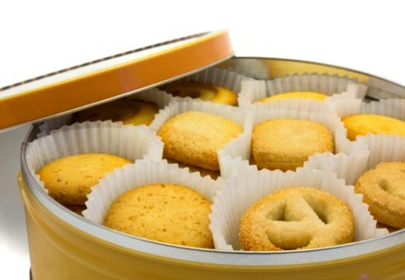 A cookie tin with butter cookies.