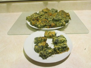 A plate of spinach and cheese appetizers.