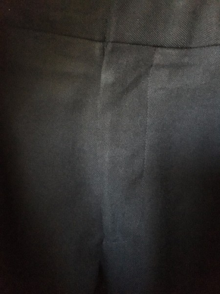 Pants being held closed with the metal prongs from a binder clip