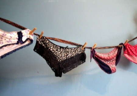 fancy feminine underwear hung as bunting