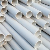 A large stack of PVC pipes.
