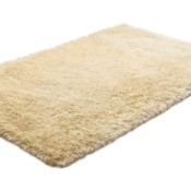 A wool rug laying on the floor.