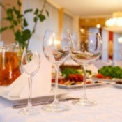 A nicely decorated banquet table with a white tablecloth.