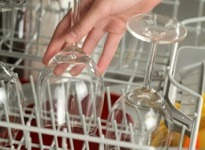 Some wine glasses in a dishwasher.