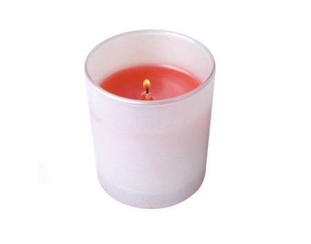 A votive candle holder with a red lit candle it in.